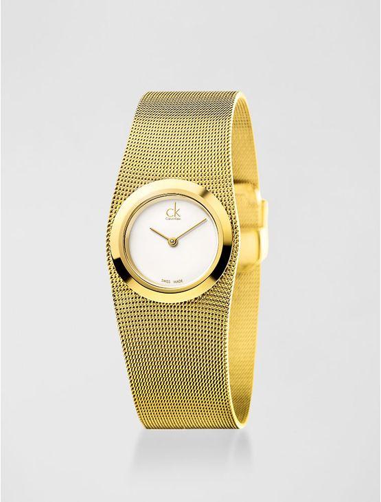 Relógio analógico feminino Calvin Klein com pulseira e caixa em aço dourado, vidro em cristal mineral. Resistência à água: 3 BAR. Mecânismo Suíço, função hora e minuto.