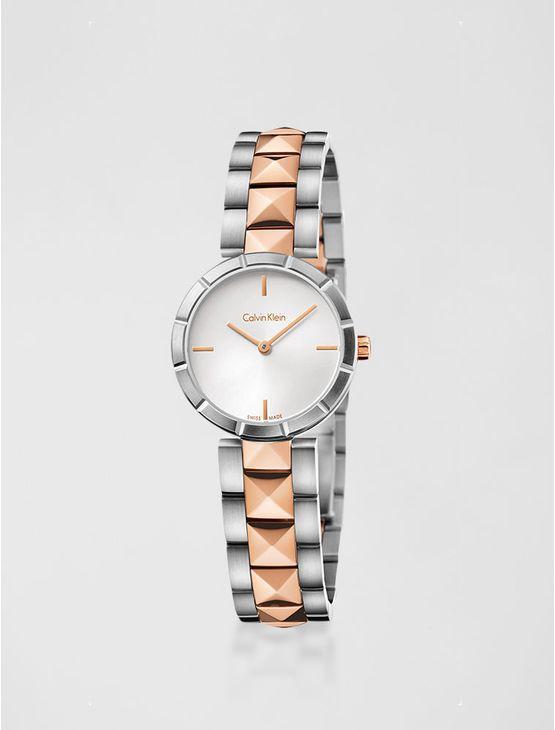 Relógio analógico feminino Calvin Klein com pulseira e caixa em aço misto com rose gold, vidro em cristal mineral. Resistência à água: 3 BAR. Mecânismo Suíço, função hora e minuto.